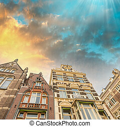 Dramatic sky over Amsterdam buildings.