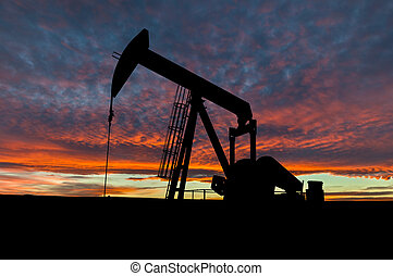 Dramatic Sky Over Pumpjack Silhouette in Rural Alberta,...
