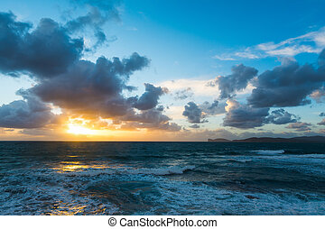 dramatic sky over the sea at sunset