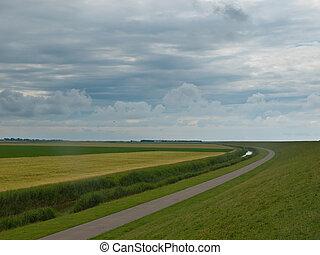 Dramatic sky above typical dutch rural landscape