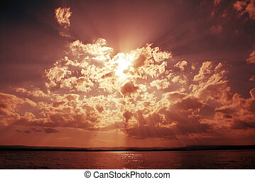 Dramatic sky with clouds and sun beams