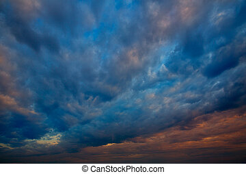 Dramatic sky with stormy clouds in sunset