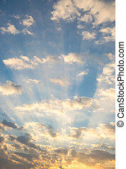 dramatic sky with sun rays, sunlight through the clouds.