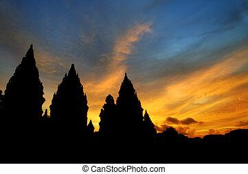 Hindu temple - Dramatic sky with sun setting at Hindu temple...