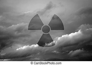 Dramatic sky with symbol of radioactivity as a background...