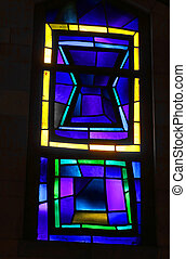 Dramatic small stained glass window in the Basilica of the Annunciation, designed by Giovanni Muzio, 1969, built over Byzantine and Crusader churches, Nazareth, Israel