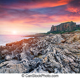 Dramatic spring sunset on the nature reserve Monte Cofano. ...