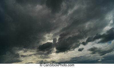 Dramatic storm clouds at dark sky in rainy season