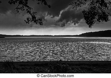 Dramatic Storm Clouds over beautiful Lemiet lake in Mazury district, Poland. Fantastic travel destination.