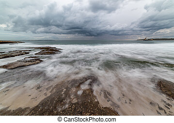 Dramatic storm seascape with moody sky and powerful surf....