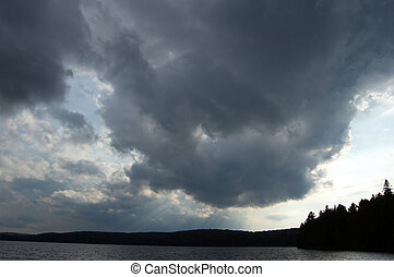 Algonquin Park - Dramatic summer cloud with sunbeam in...