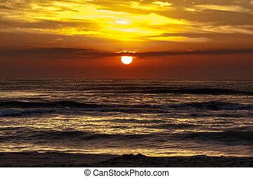 Dramatic sunrise or sunset at sea