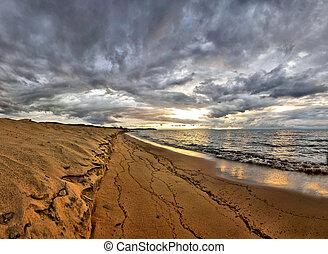 Sunrise over Lake Malawi on beach