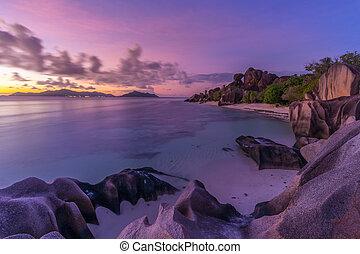 Dramatic sunset at Anse Source d'Argent beach, La Digue island, Seychelles