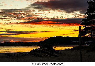 dramatic sunset at norwegian fjord