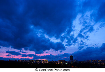 Dramatic sunset in blue tone over the city