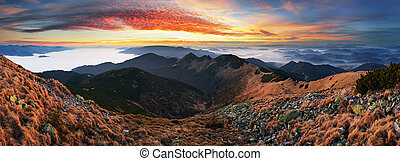 Dramatic sunset in fall mountain landscape