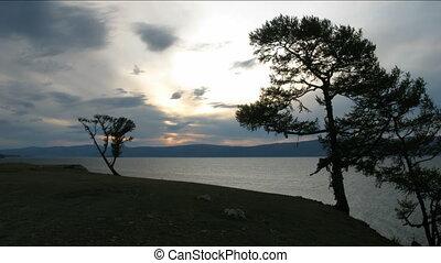 Dramatic sunset on Baikal lake. Olkhon island.