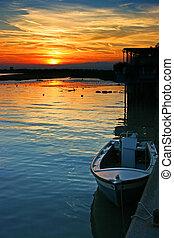 Dramatic sunset on Tagliamento river, Friuli, Italy