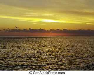 Dramatic sunset over the sea on Cuban beach