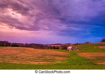 Dramatic sunset sky over a farm in rural York County, Pennsylvan