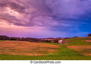 Dramatic sunset sky over a farm in rural York County, Pennsylvan