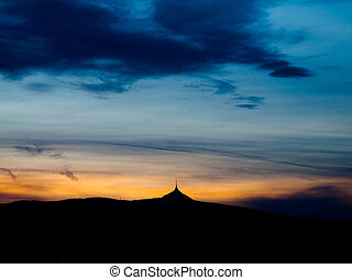 Dramatic sunset sky with Jested ridge silhouette
