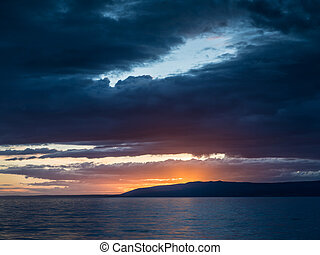Dramatic sunset with dark clouds in Istria