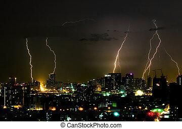 Dramatic thunder storm lightning bolt on the horizontal sky and city scape