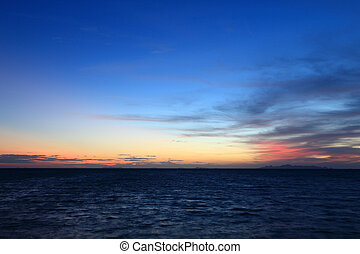 dramatic tropical sunset sky and sea at dusk