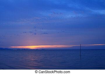 Dramatic tropical vivid sky and sea at dusk