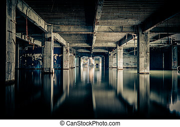 Dramatic view of damaged and abandoned building sunken by...