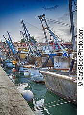Dramatic view on fishing boats