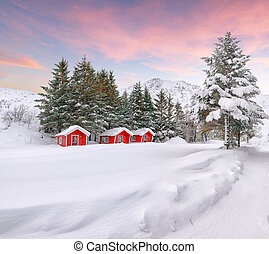 Dramatic winter scenery with traditional Norwegian red wooden houses on the shore of Rolvsfjord on Vestvagoy island