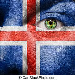 drapeau, peint, sur, figure, à, oeil vert, montrer, islande, soutien