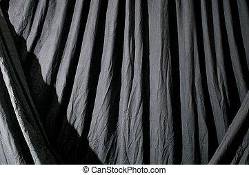 Draped black background cloth