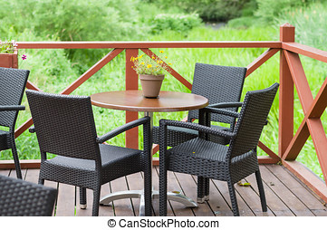 drau en st hle holz terrasse meer tisch ansicht. Black Bedroom Furniture Sets. Home Design Ideas