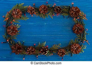Weihnachtsbeleuchtung Kegel.Tanne Segeltuch Zweige Kegel Rahmen Hintergrund Weihnachten