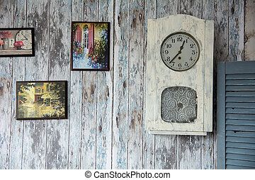 Draw a picture and clock on the old wall.