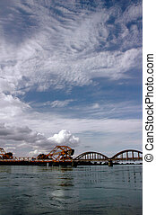 Draw Bridge, Blue Sky and White Clouds
