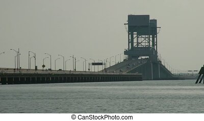 A compressed telephoto shot of the James River Bridge in Newport News, Virginia.