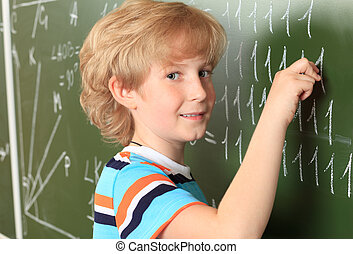 draw graphs - Portrait of a cute schoolboy with a book in a...