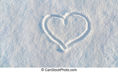 Draw of heart on the white snow
