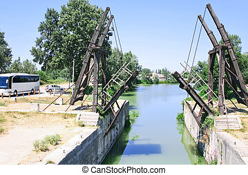 drawbridge (Van Gogh bridge) through canal near Arles, France