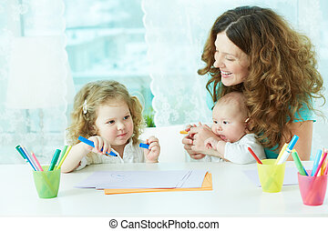 Drawing at home - Beautiful mother and her children drawing...