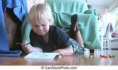 Drawing boy - Young boy drawing on the floor