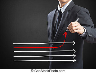 Drawing different directions - Businessman drawing arrows in...