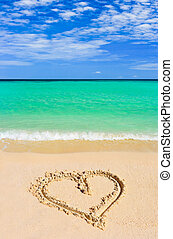 Drawing heart on beach