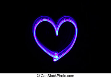 Drawing heart with light in the dark
