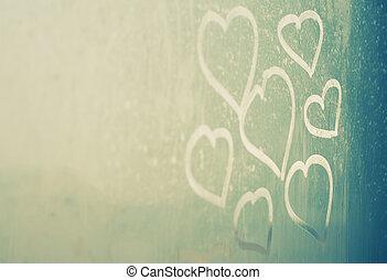 drawing hearts on wet window
